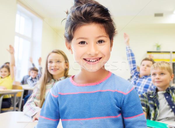 little school girl over classroom background Stock photo © dolgachov