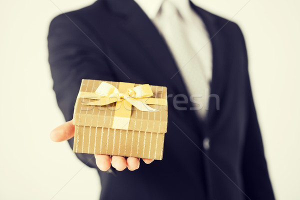 man hands holding gift box Stock photo © dolgachov