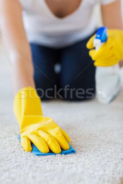 close up of woman with cloth cleaning carpet Stock photo © dolgachov