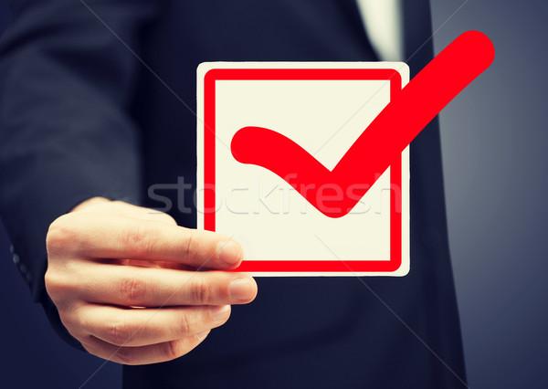 флажок красный фотография бумаги Сток-фото © dolgachov