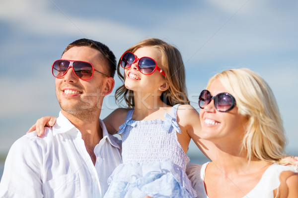 happy family with blue sky Stock photo © dolgachov