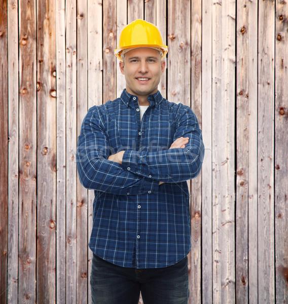 Sonriendo masculina constructor manual trabajador casco Foto stock © dolgachov