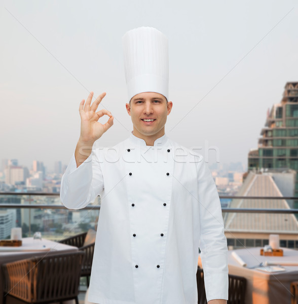 Heureux Homme chef Cook Photo stock © dolgachov