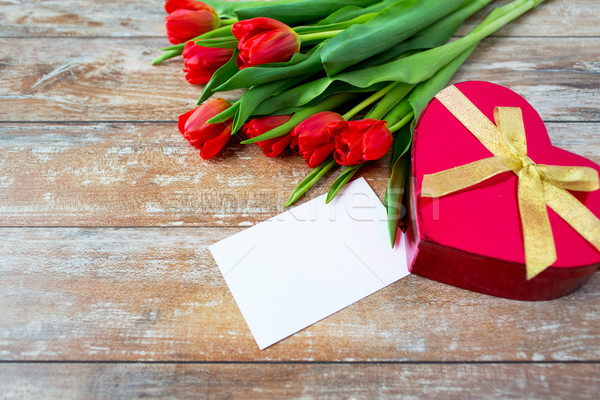 close up of red tulips, letter and chocolate box Stock photo © dolgachov