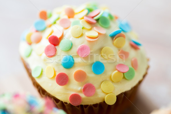 close up of glazed cupcake or muffin on table Stock photo © dolgachov