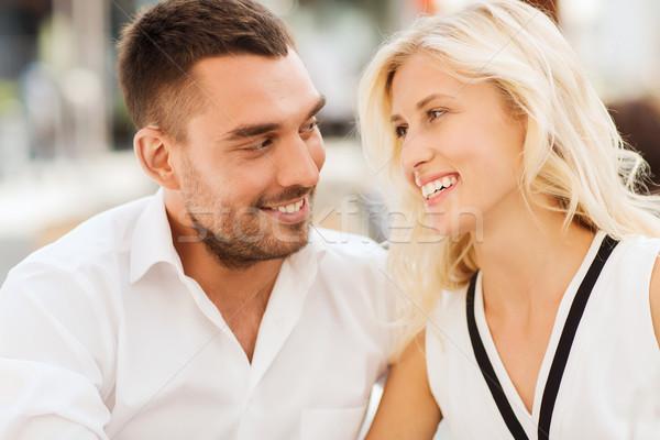 smiling happy couple outdoors Stock photo © dolgachov