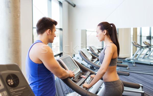 Nő edző futópad tornaterem sport fitnessz Stock fotó © dolgachov