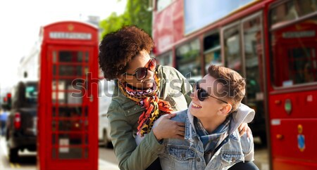 close up of gay couple hugging over london city Stock photo © dolgachov