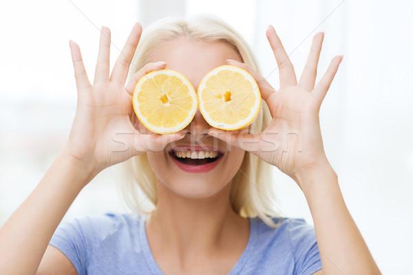 Feliz mujer ojos limón alimentación saludable Foto stock © dolgachov