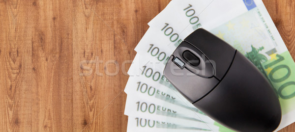 close up of computer mouse and euro money Stock photo © dolgachov