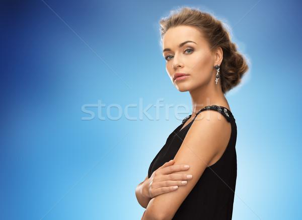 Gyönyörű nő visel fülbevalók kék emberek ünnepek Stock fotó © dolgachov