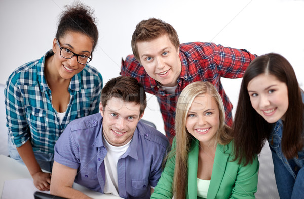 group of happy high school students or classmates Stock photo © dolgachov
