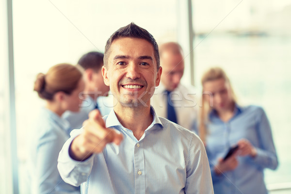 group of smiling businesspeople meeting in office Stock photo © dolgachov
