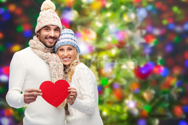 Stock photo: smiling couple in winter clothes with red hearts