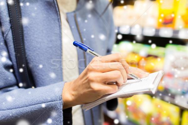 Stock fotó: Közelkép · nő · ír · jegyzettömb · élelmiszer · vásár
