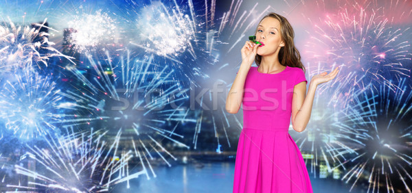 Stock photo: happy young woman party horn over firework at city