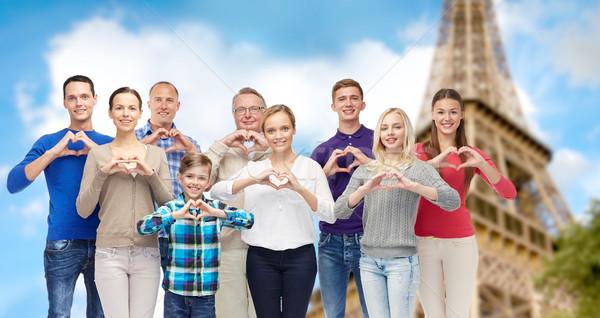 Insanlar kalp el işareti Eyfel Kulesi jest Stok fotoğraf © dolgachov