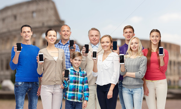 group of people with smartphones over coliseum Stock photo © dolgachov