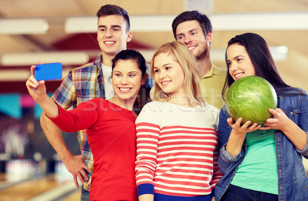 Photo stock: Heureux · amis · smartphone · bowling · club · personnes