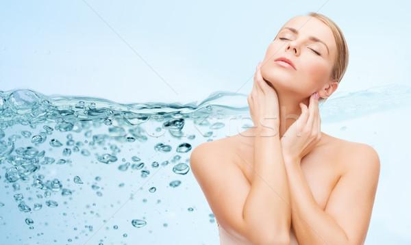Mulher jovem tocante pescoço beleza pessoas Foto stock © dolgachov