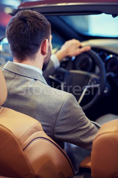 Człowiek kabriolet samochodu auto pokaż Zdjęcia stock © dolgachov