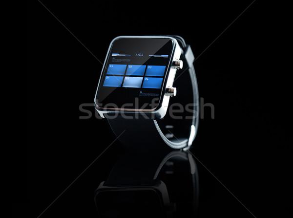 close up of black smart watch interface Stock photo © dolgachov