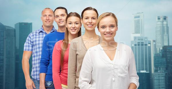 Grupo sorridente pessoas cidade edifícios família Foto stock © dolgachov
