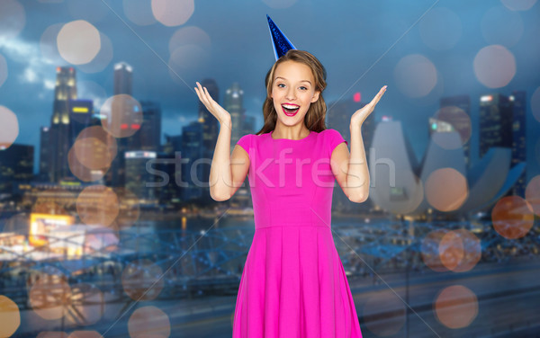 Stock photo: happy young woman or teen girl in party cap