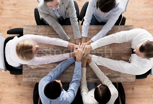 Equipo de negocios manos superior gente de negocios cooperación Foto stock © dolgachov