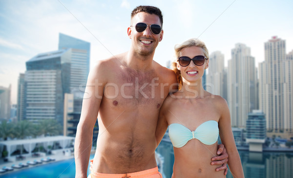 happy couple in swimwear over dubai city waterside Stock photo © dolgachov