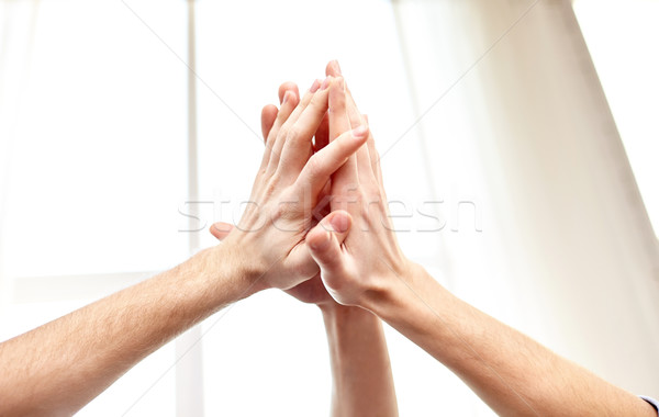 close up of hands making high five gesture Stock photo © dolgachov