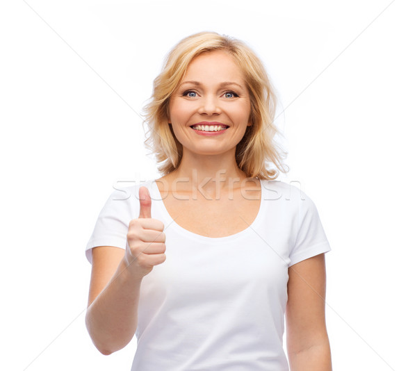 smiling woman in white t-shirt showing thumbs up Stock photo © dolgachov