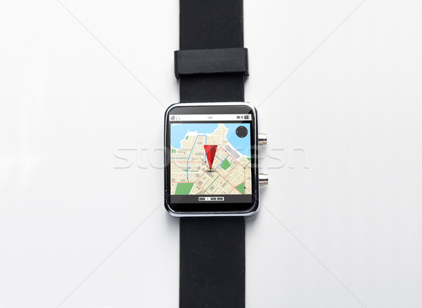 close up of smart watch with gps navigator map Stock photo © dolgachov