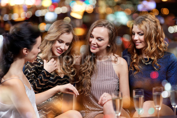 woman showing engagement ring to her friends Stock photo © dolgachov