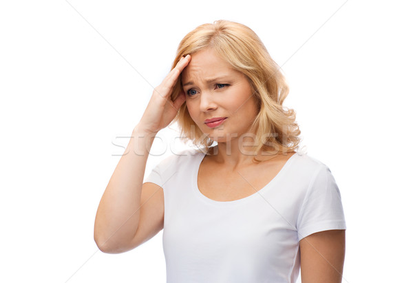 Stock photo: unhappy woman suffering from headache