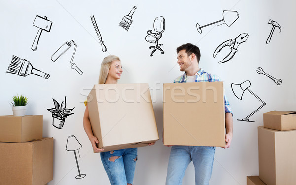 smiling couple with big boxes moving to new home Stock photo © dolgachov