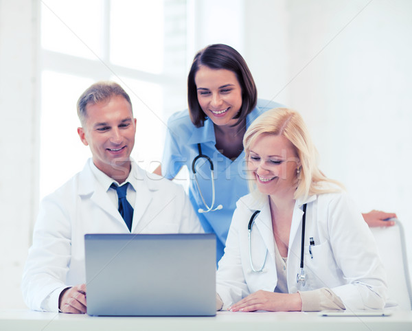group of doctors looking at tablet pc Stock photo © dolgachov