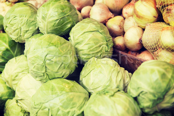 close up of cabbage and onion at street market Stock photo © dolgachov