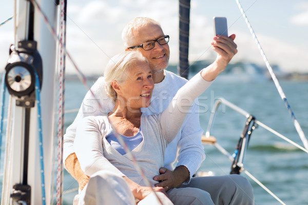 senior couple taking selfie on sail boat or yacht Stock photo © dolgachov