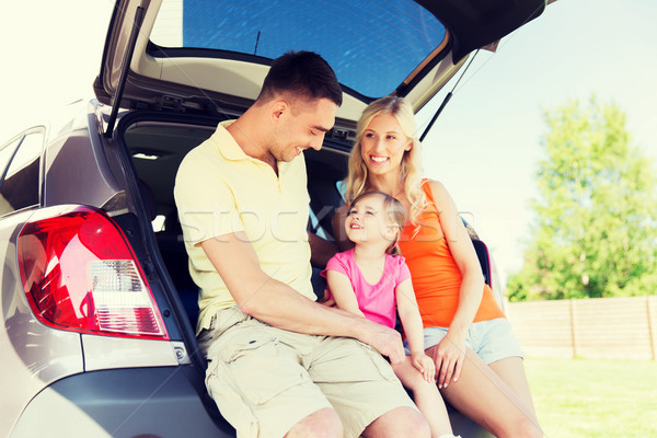 happy family with hatchback car outdoors Stock photo © dolgachov