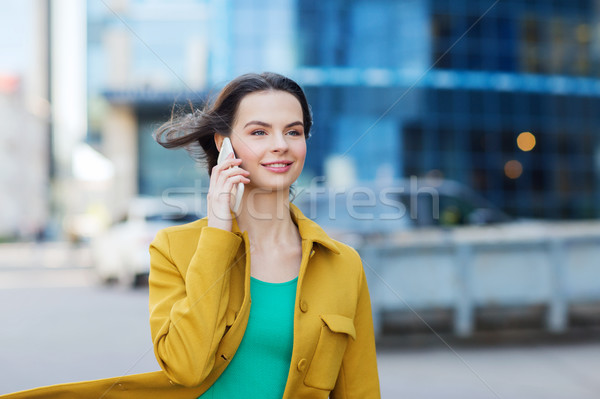 smiling young woman or girl calling on smartphone Stock photo © dolgachov