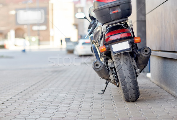close up of motorcycle parked on city street Stock photo © dolgachov