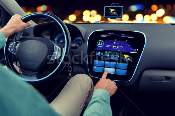 close up of man driving car with navigation system Stock photo © dolgachov
