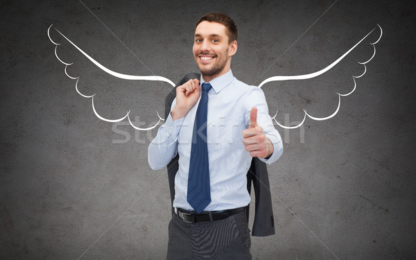 businessman with angel wings showing thumbs up Stock photo © dolgachov