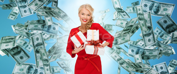 happy woman in red with gifts over money rain Stock photo © dolgachov