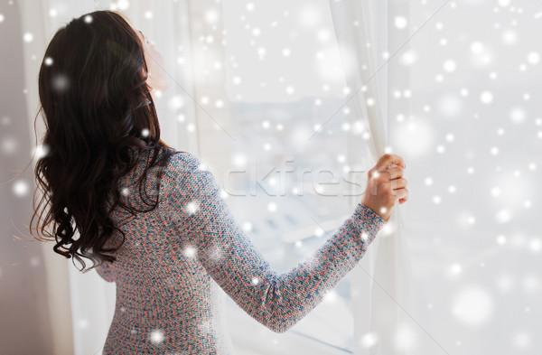 женщину открытие окна шторы люди Сток-фото © dolgachov