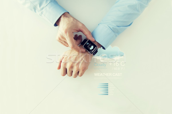 hands with weather forecast app on smart watch Stock photo © dolgachov