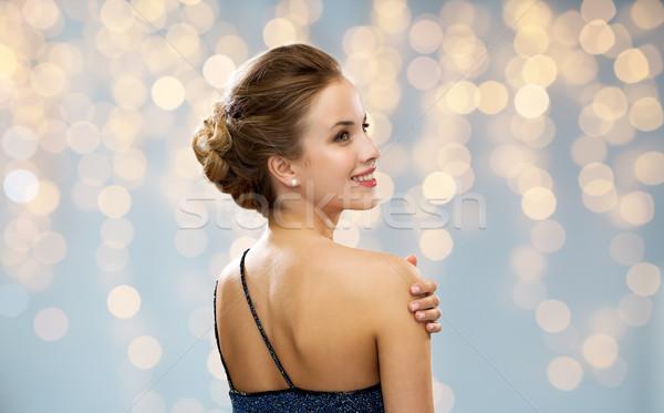 Mulher vestido de noite de volta luzes pessoas férias Foto stock © dolgachov