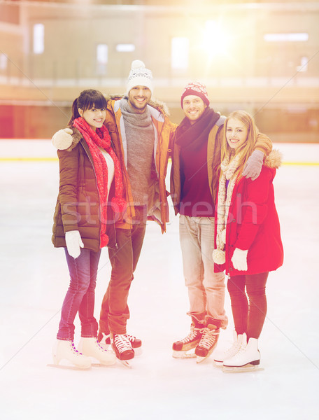 happy friends on skating rink Stock photo © dolgachov