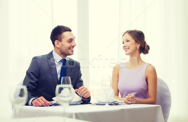 smiling couple looking at each other at restaurant Stock photo © dolgachov